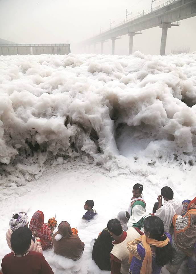 People offering prayers at River Yamuna, India, which is frothing from industrial waste. This picture of the Yamuna river in New Delhi will make your heart sink! What world are we going to leave for our children? — met Armaan Bhati.