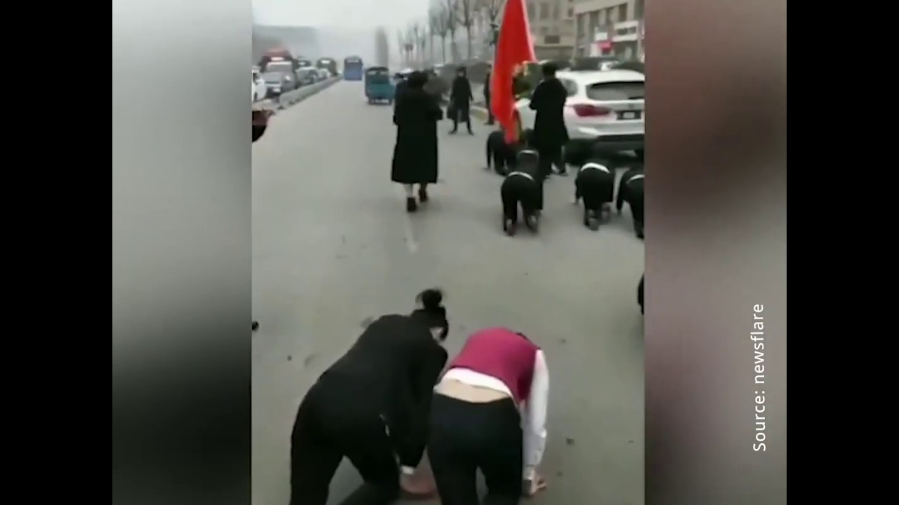 VIDEO: Chinese Workers Forced To Crawl The Streets As Punishment for Not Meeting Company's Goals